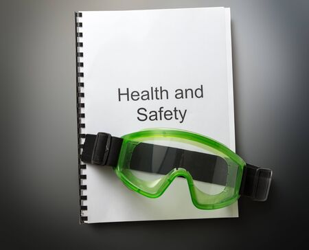 eyeshield: Health and safety register with goggles in closeup