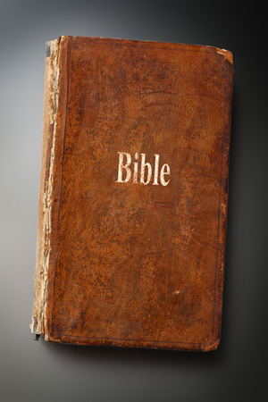scratchy: Old Bible book on steel scratchy background