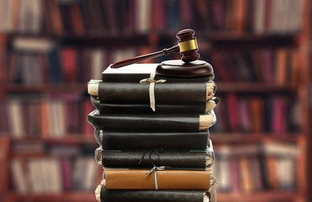 law report: Stack of old paper folders and gavel