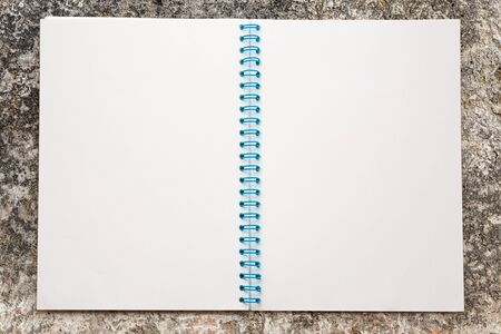 Blank open notepad on the steel background photo