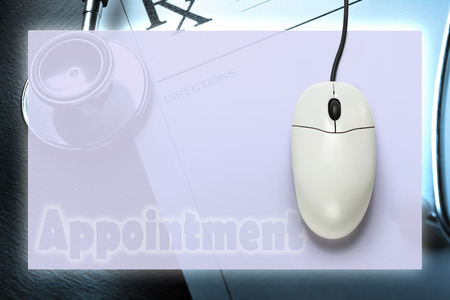 Computer mouse on medical background  in closeup photo