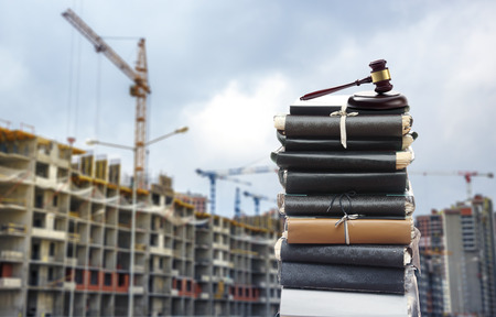 construction: Document files with gavel on buildings under construction