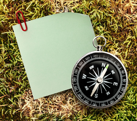 Blank green sticker with red clip and compass photo