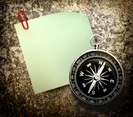 Blank green sticker with red clip and compass