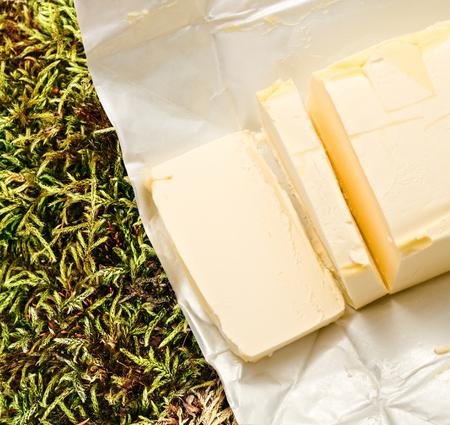 margarine: Margarine opened and cut fresh in closeup