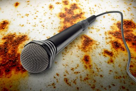 rusty background: Black microphone on the rusty background closeup Stock Photo
