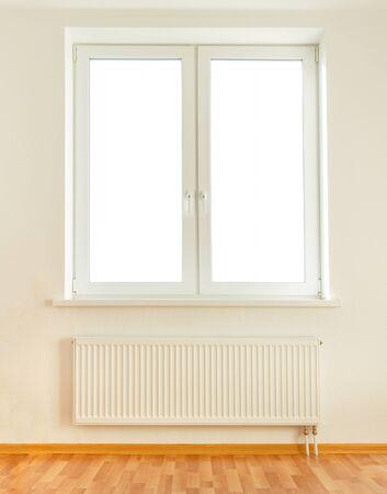 convective: White plastic double window with radiator under it