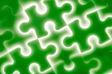 teamwork together: Background of large shining puzzles in green