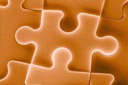 Jigsaw puzzle pieces as background in closeup