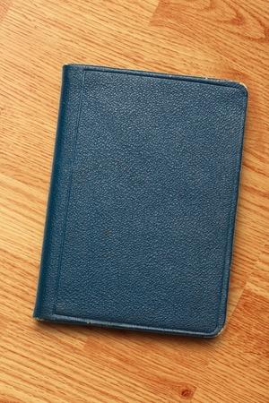 billfold: Dark blank blue notebook closed in closeup Stock Photo