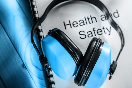 personal safety: Health and safety register with earphones in blue toning