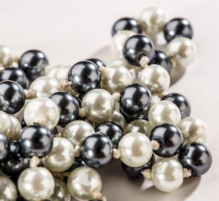 string of pearls: String of black and white pearls in closeup