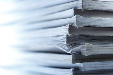periodical: Stack of old magazines as background  in toning Stock Photo