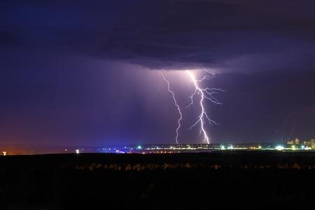 thundershower: Night thunder lightning over the city sky view