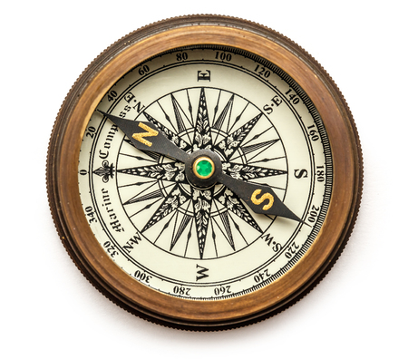 compass: Vintage brass compass on background in closeup Stock Photo