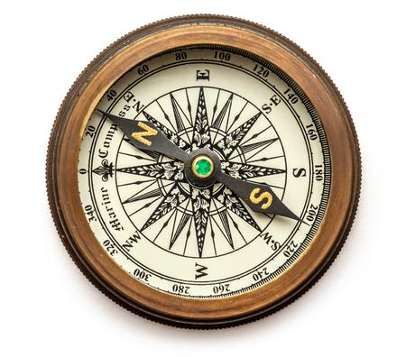 Vintage brass compass on background in closeup Standard-Bild