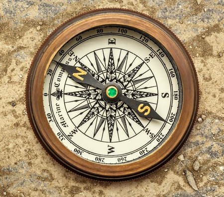 magnetic stones: Vintage brass compass on background in closeup Stock Photo