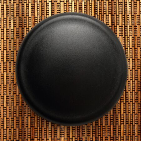 black button: Blank black button as background in closeup