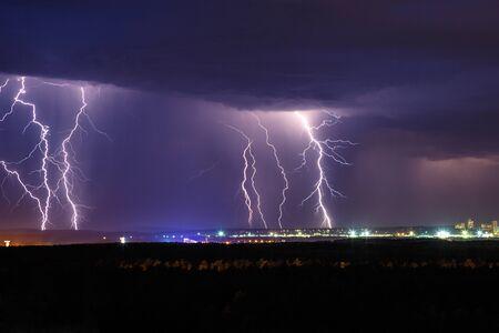lightning strike: Night thunder lightning over the city sky view
