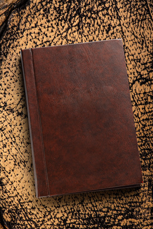 closed book: Brown closed book on the leather background Stock Photo