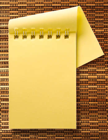 yellow notepad: Yellow notepad on the textured background