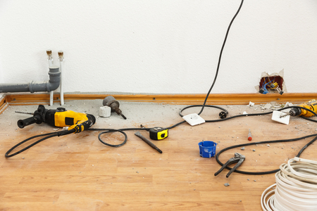 electric socket: Place of electric socket repair process with drill