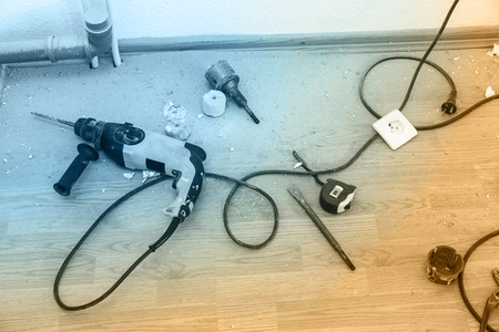 making hole: Place of electric socket repair process with drill