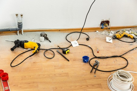 hole in wall: Place of electric socket repair process with drill
