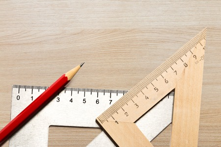 drafting tools: Drafting wooden and steel tools with pencil in closeup