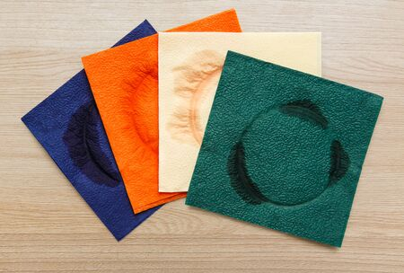 servilletas: Used napkins in closeup on wooden background Foto de archivo