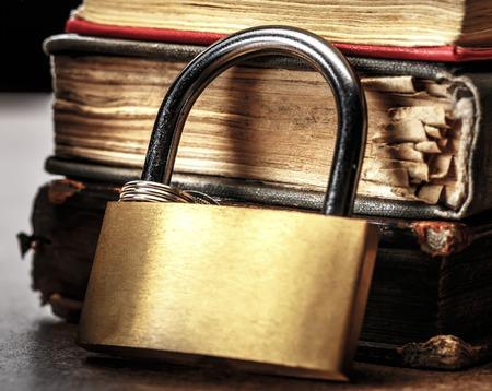 press media: Key lock against the background of books Stock Photo