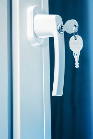 close fitting: Handle plastic windows with keys in closeup