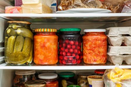 glass jars: Pickled vegetables in jars on shelf in refrigerator