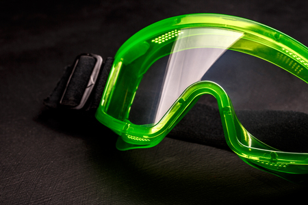 eyeshield: Green safety eye shields with strap in closeup