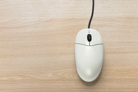 scrollwheel: Computer mouse on the wooden background  in closeup Stock Photo