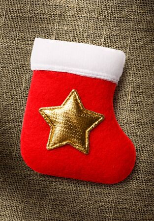 star ornament: Red christmas stocking with golden star ornament