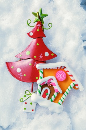 white house: Christmas tree and house decoration on snow background Stock Photo