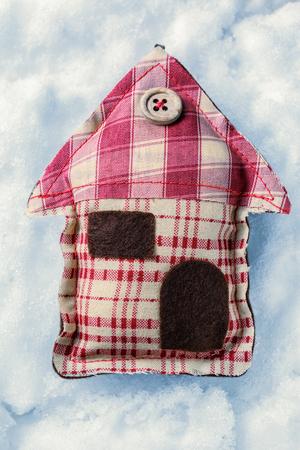 christmas house: Christmas decorative house on the snow background Stock Photo