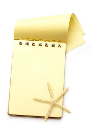 yellow notepad: Yellow notepad with sea star on white background Stock Photo