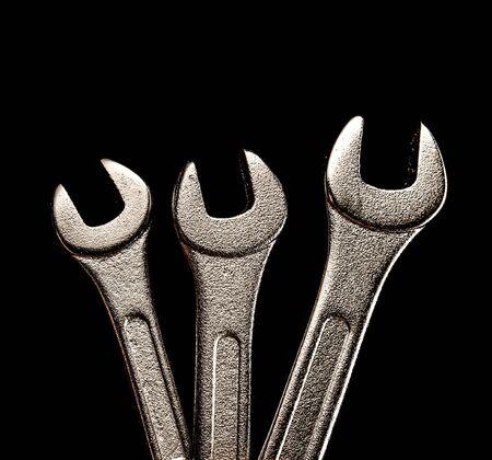 wrenches: Three metallic wrenches on black background closeup Stock Photo