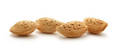 hard core: Dry almond nuts on the white background