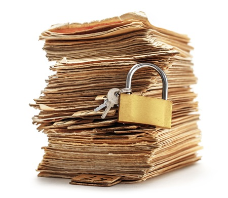 keylock: Pile of old cards with keylock in closeup