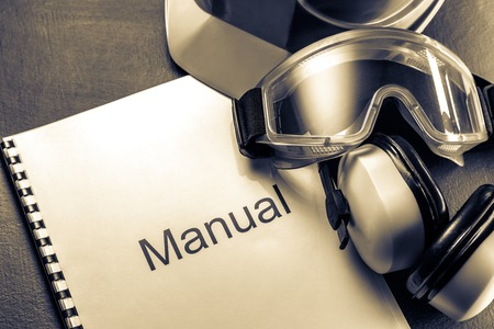 Manual with helmet, goggles and headphones in toning Stock Photo