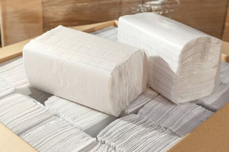 sanitary towel: Paper napkins and towels in closeup as background Stock Photo