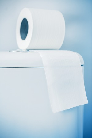hygienic: Hygienic paper on white toilet tank closeup