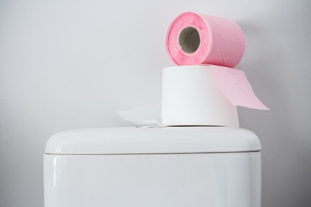 hygienic: Hygienic paper on white toilet tank closeup