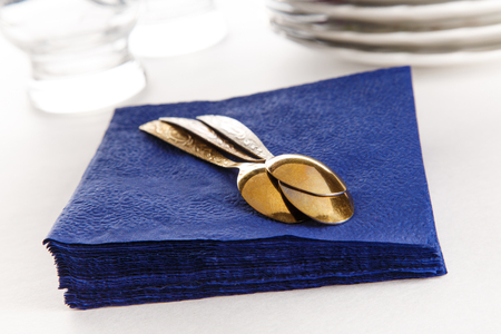 glass paper: Stack of paper napkins with spoons, plates and glasses