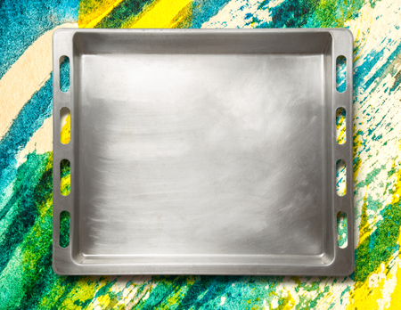 oven tray: Empty metal oven tray on colorful background Stock Photo