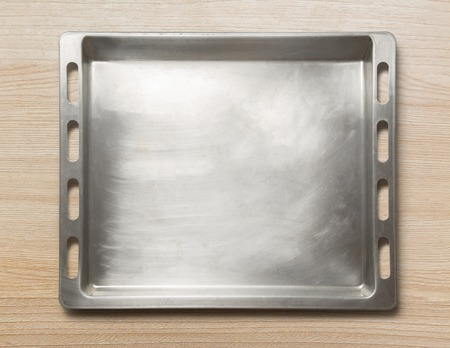 oven tray: Empty metal oven tray on wooden background