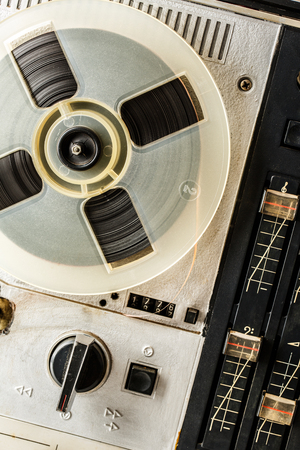 turn dial: Old reel tape recorder in closeup used
